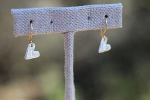 Show The Love Earrings on stand