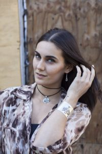 Model wears Silver Age of Aquarius on black leather cord and Phoenix Heart cuff